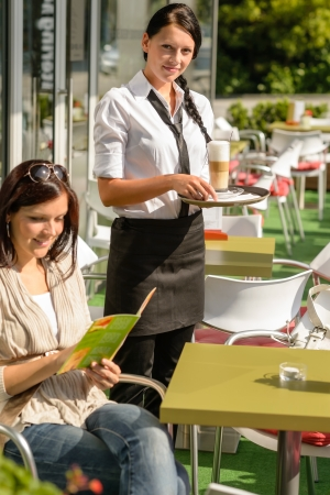 Woman checking menu waitress bringing order coffee cafe bar smiling Stock Photo - 15035950