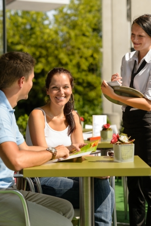 Couple at cafe ordering from menu waitress man point menu Stock Photo - 15035947
