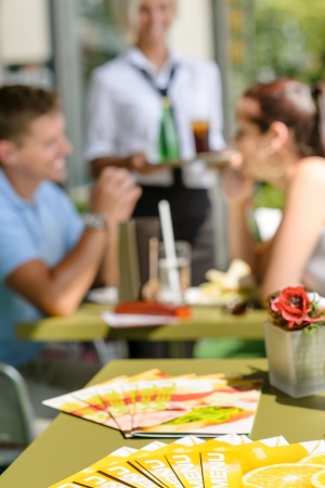 Menus at cafe bar restaurant terrace people selective focus couple Stock Photo - 15035999