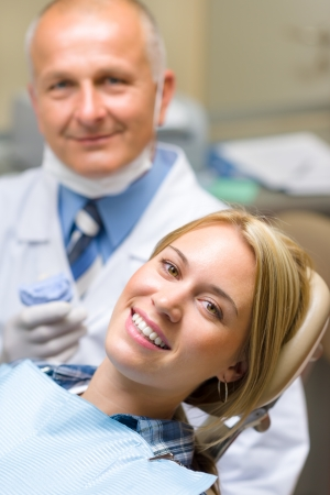 male dentist: Healthy patient at dentist office have teeth checkup stomatology