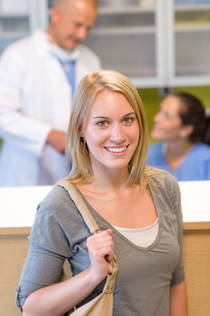 Visit at the dentist beautiful smile woman check-in appointment reception photo
