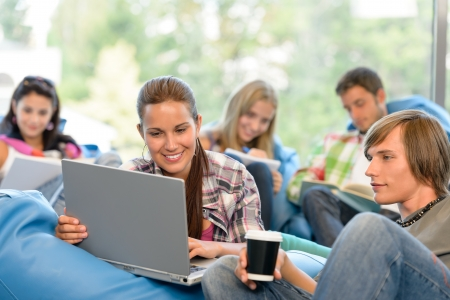 group study: Students working on project in study room high-school teens laptop Stock Photo