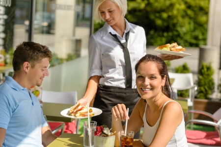 Waitress bring couple lunch food restaurant sunny terrace sandwiches Stock Photo - 15072960