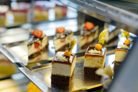 cafeteria tray: Cake and pastry in window display canteen food dessert tasty