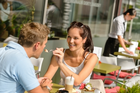 afters: Woman feeding man cheesecake at cafe couple flirting romantic happy