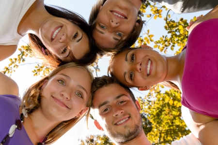 Teens in a circle smiling in park leisure students friends photo