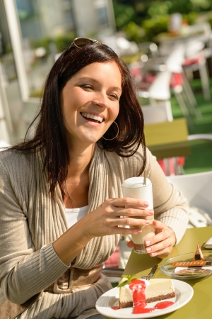 coffee time: Woman at cafe bar holding latte drink smiling happy coffee