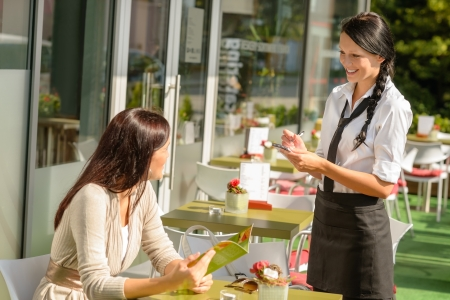 Waitress taking woman Stock Photo - 15154808