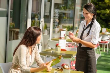 taking a break: Waitress taking woman