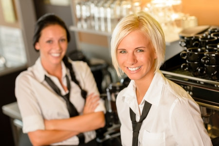 Cafe waitresses behind bar smiling at work break women colleagues Stock Photo - 15154801