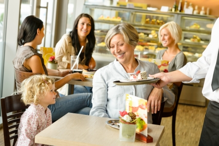 wanting: Grandmother and grandchild waiting cake order cafe dessert waiter plate