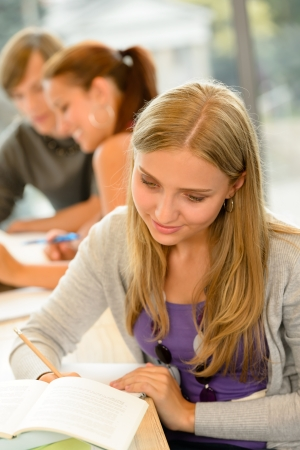 high school students: High-school student taking notes in library study academic campus teenager Stock Photo