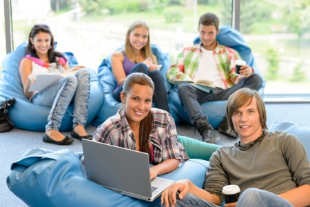 pouf: Students sitting on beanbags study room high-school teens happy