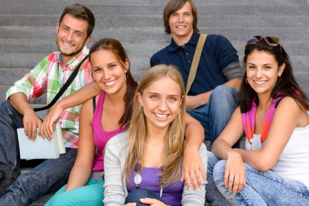 Students sitting on school stairs smiling teens campus college friends