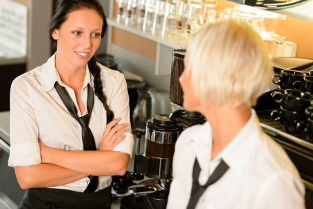 Waitresses talking gossiping in break cafe women smiling friends bar photo