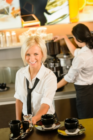 Waitress serving coffee cups making espresso woman cafe bar working Stock Photo - 15174000