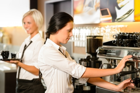 making coffee: Staff at cafe making coffee espresso machine woman working bar Stock Photo