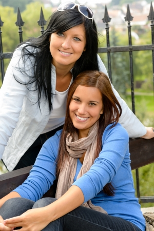 Mother and daughter in the park smiling teen together loving Stock Photo - 15262864