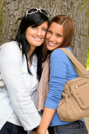 Mother and daughter spending time together park happy teen loving Stock Photo - 15262865