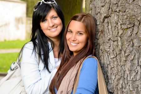 Mother and daughter spending time together park happy teen loving Stock Photo - 15262867