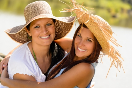 Mother and daughter hugging outdoors summer teen vacation straw hats Stock Photo - 15262862