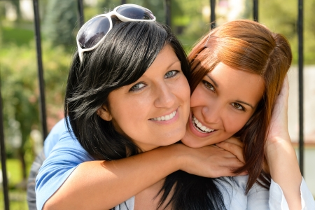 Daughter hugging her mother outdoors happy loving teen bonding affectionate photo