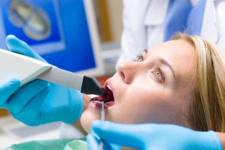 Woman with open mouth and dental tools  have teeth checkup photo