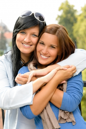 mid teens: Teen and her mother embracing outdoors bonding daughter happy relaxing