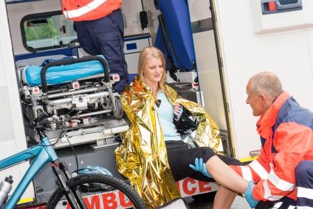 Emergency paramedics with woman bike accident in ambulance help injury Stock Photo - 15335912