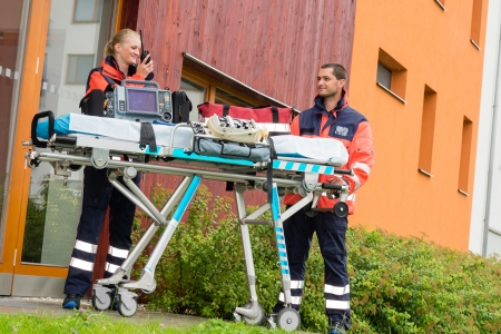 emergency call: Paramedics emergency home visit call radio ambulance doctor help Stock Photo