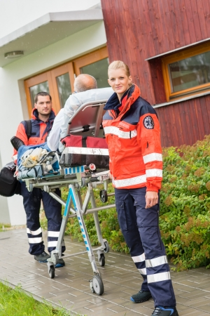Paramedics with patient on emergency stretcher ambulance aid woman man Stock Photo - 15335910