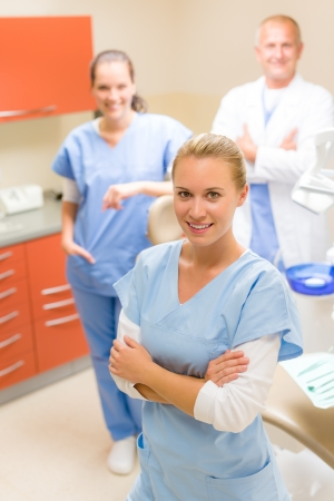 Portrait of dental team female dentist with colleagues photo