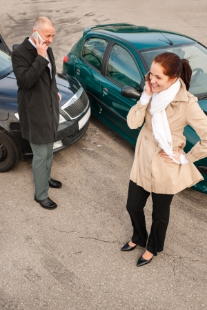 Woman and man on phone car crash accident calling problem photo