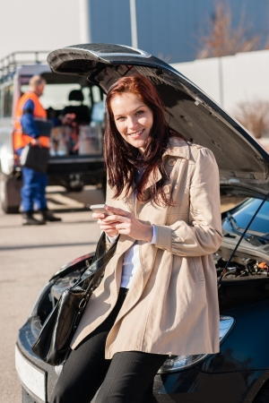 Woman dialing her phone after car breakdown problem mechanic crash photo