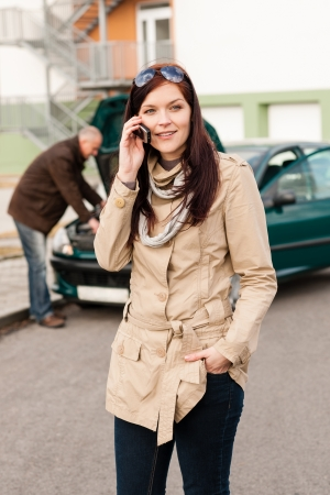 Woman on the phone repairman fixing car breakdown crash problem photo