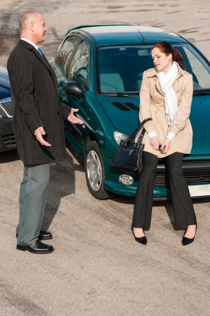 collision: Man and woman talking after car crash sad guilt problem Stock Photo