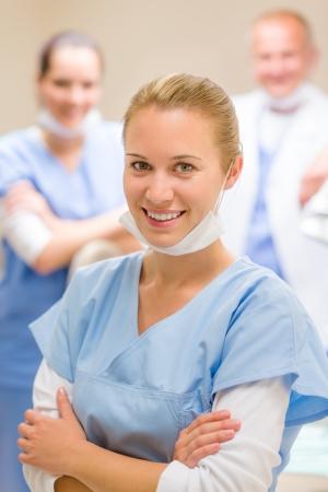 кавказцы: Портрет стоматологической команды улыбается женщина медсестра с коллегами Фото со стока