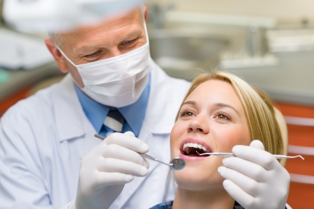 dental caries: Healthy teeth patient at dentist office dental caries prevention