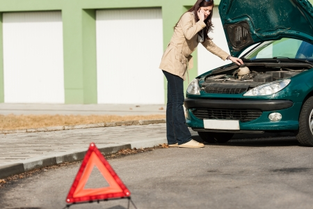 broken car: Car breakdown couple calling for road assistance look engine Stock Photo