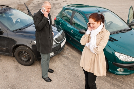 car trouble: Woman and man on phone car crash accident calling problem