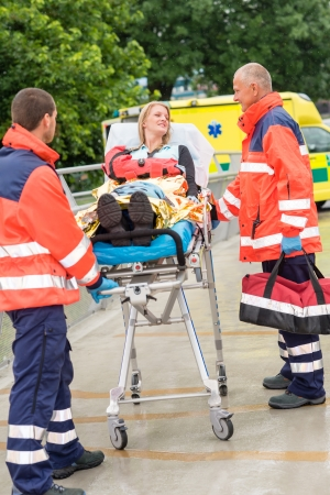 Patient talking with paramedics after accident  aid emergency arm injury photo
