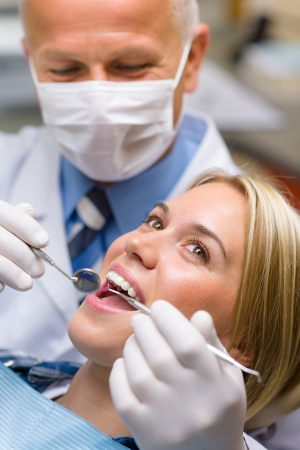 male dentist: White teeth woman patient at the dentist decay prevention