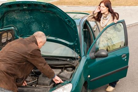 road assistance: Car breakdown woman calling for road assistance man repair motor Stock Photo