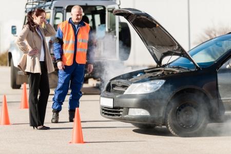 man smoking: Car breakdown woman get help road assistance man smoking engine