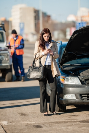 Woman on the phone after car crash breakdown talking upset photo