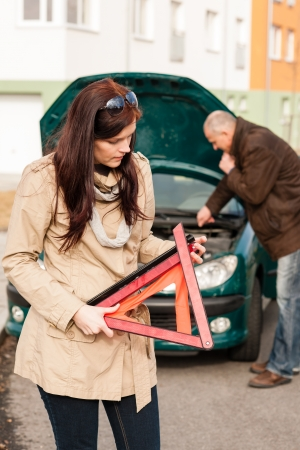 Woman worried about broken car warning sign breakdown crash problem photo