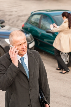 Man on the phone after colliding car woman accident crash