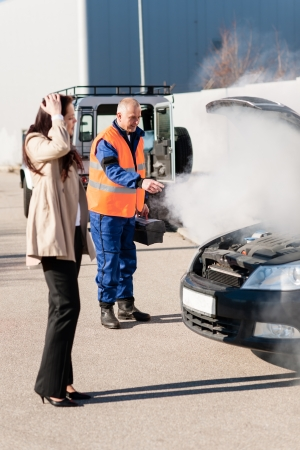 car trouble: Woman with technician help smoking engine car breakdown trouble accident Stock Photo