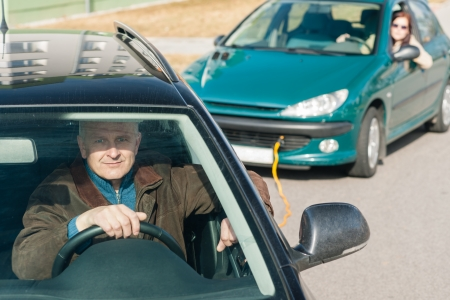 car trouble: Man helping woman by pulling her car breakdown problem trouble Stock Photo