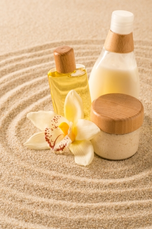 Spa body product on sand orchid flower beauty treatment